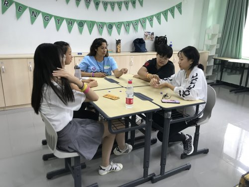 Melinda playing LCR with her students